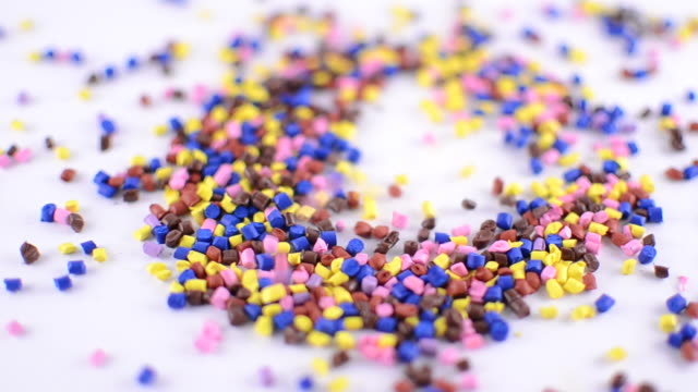 Colorful polymer granules falling