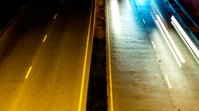 Colorful Traffic Light and Fast Moving Car in Tunnel at Night, Time Lapse Video