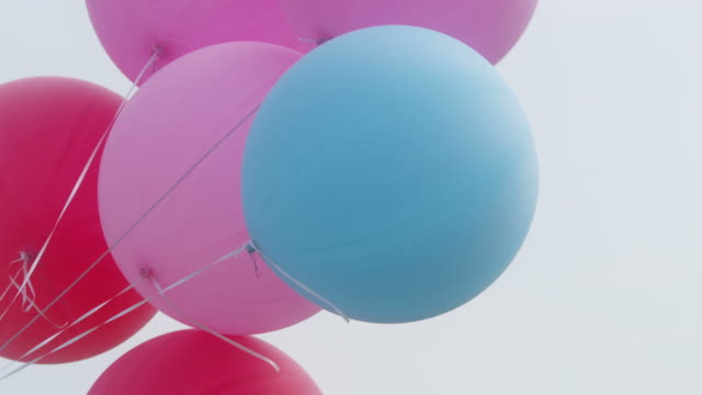 colourful big balloons flying in the air with clear sky
