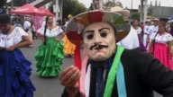 A colourful parade toured the streets of El Salvador's capital Saturday to promote tourism in the country with residents dressed up as imaginative...