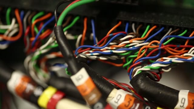 Colourful wires plugged into a machine in a server room in London United Kingdom on Friday 24th October gvs of various colourful wire setups pull...