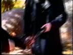 Columbine killers Eric Harris and Dylan Klebold joking after shooting guns in wood for video made six weeks before school massacre/ Littleton...