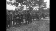 Column of disarmed Russian soldiers walking along road / disarmed Russian cavalry riding past camera disarmed Russian soldiers walking past camera...