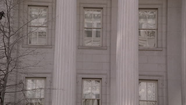 LA Columns and windows of the U.S. Treasury Department building / Washington, D.C., United States