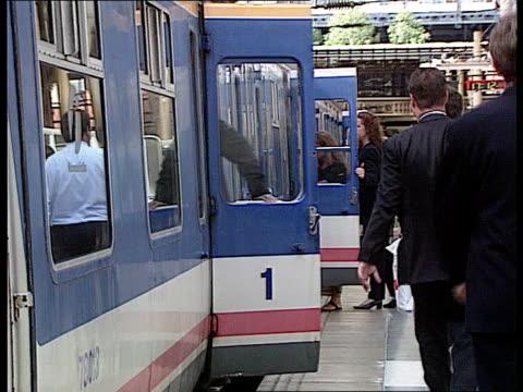 Coma woman left on train LIB ENGLAND London Liverpool Street Station MS commuters boarding slam door train GV guard closing doors left open MS train...