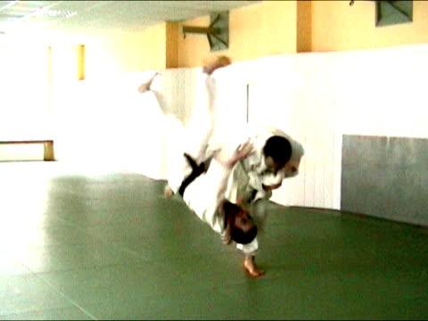 Combat: men practising judo