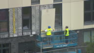 Combustible cladding being removed from a tower block in Salford after the Grenfell Tower tragedy
