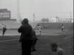 Comedian JERRY LEWIS wearing New York Giants baseball uniform standing on field in Los Angeles pointing chatting with someone offscreen singer DEAN...