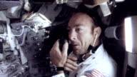 Commander Alan Shepard shaving in space smiling for camera / Command Module Pilot Stuart Roosa floating in zero gravity / Ed Mitchell shaving