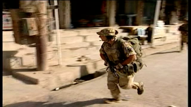 NATO commanders call for more troops Armed soldiers along on street PAN Soldiers towards on foot patrol through Afghan streets