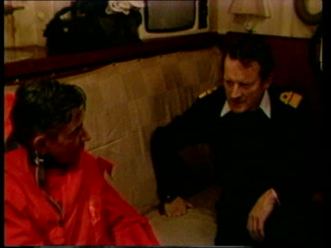 Commanders / Injured / Prisoners On Board HMS Fearless LMS Major General Jeremy Moore from helicopter and across deck shakes hands MS Moore and John...