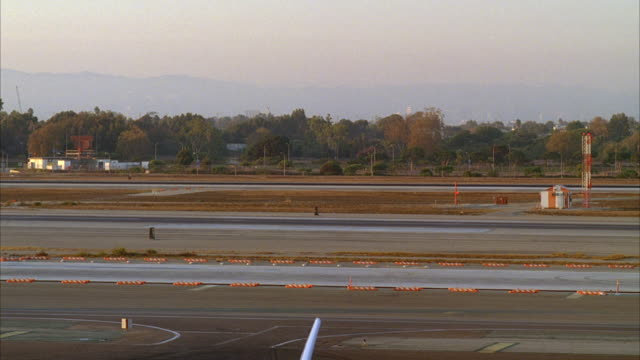 WS, Commercial aircraft taking off from airstrip, Los Angeles, California, USA