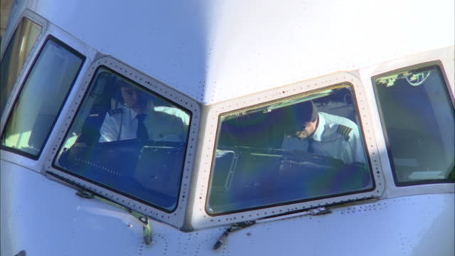 CU, HA, Commercial aircraft's pilots sitting in cockpit, Los Angeles, California, USA