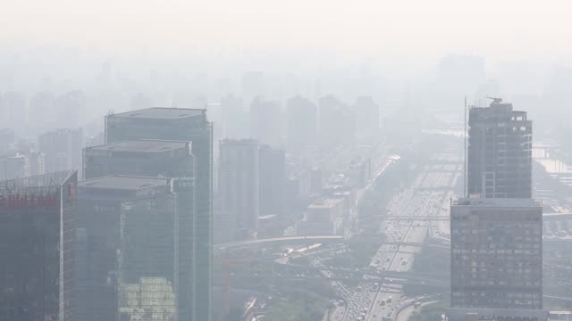 Commercial and residential buildings stand in smog in Beijing China on Tuesday Sept 9 2014