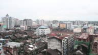 Commercial and residential buildings stand in Yangon Myanmar on Tuesday Oct 6Pan left to right and right to left commercial and residential buildings...