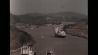 Commercial boats on Rio Chagres river MS Ship moving across body of water MS Lykes Lines cargo ship moving across Lake Gatun motorboat FG Shipping...