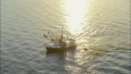 WS POV AERIAL Commercial fishing boat moving in sea at dawn / New Orleans, Louisiana, USA