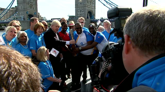 Queen's Baton arrives in London Close shot Christine Ohuruogu holding baton Christine Ohuruogu interview SOT On training for Commonwealth Games...