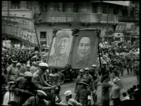 Communist Chinese soldiers marching in Shanghai street People greeting Chairman Mao Zedong outside shaking hands