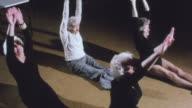1983 MONTAGE Community center residents sitting together, doing needlepoint, exercising, doing laundry, using walker to enter kitchen / United Kingdom