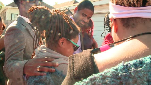 WGN Community Members Pray At Site Where 9YearOld Boy Was Shot then pass out flyers seeking information Chicago police say 9yearold Tyshawn Lee who...