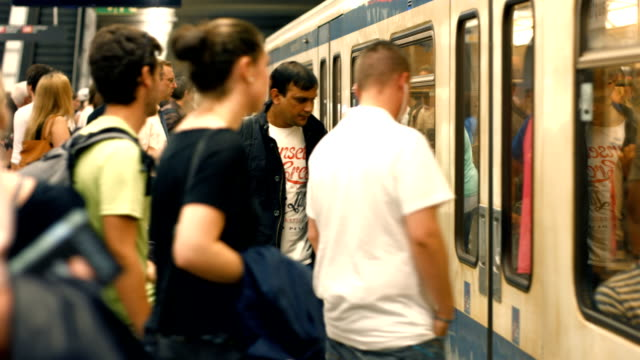 T/L Commuters Boarding Subway Train (4K/UHD to HD)