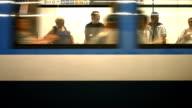 T/L Commuters Boarding Subway Train