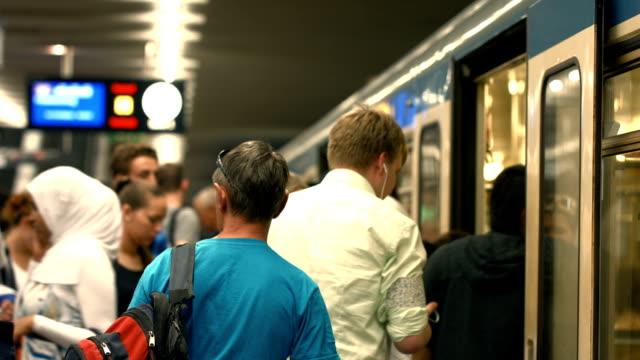 Commuters Boarding Subway Train (4K/UHD to HD)