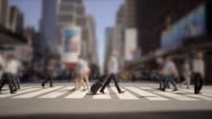 commuters crossing street in slow motion. city business shopping district