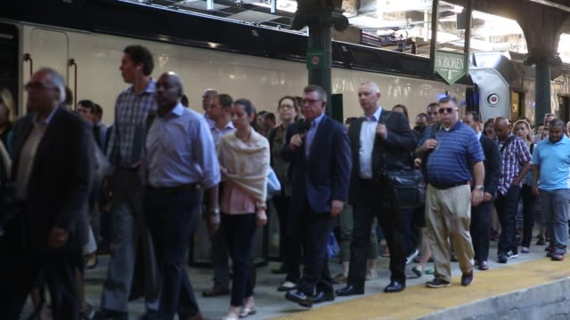Commuters disembark from New Jersey Transit trains to take ferries or PATH trains during a morning commute to Penn Station on the first day of...