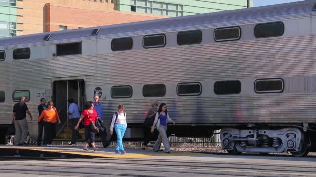 Commuters exit a metra train at the Des Plaines Illinois station stop Union Pacific Northwest Line