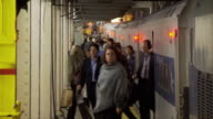 T/L CU Commuters exiting subway train on platform / New York City, New York, USA