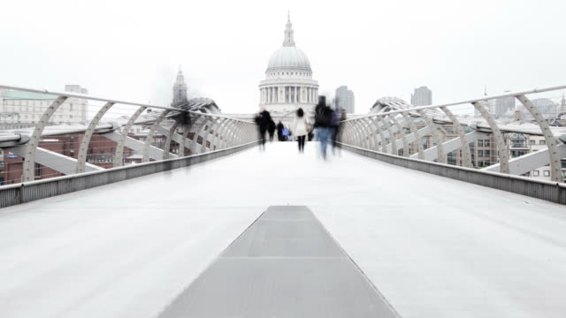commuters in Millennium bridge
