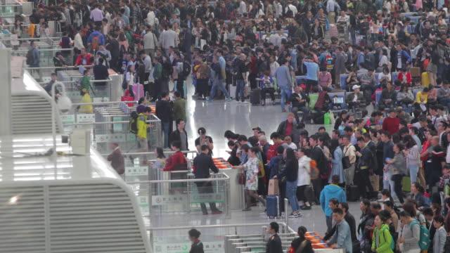 Commuters in modern train station