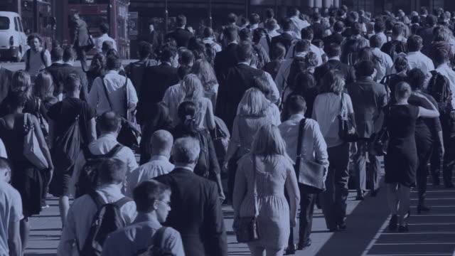 Commuters make their way across London Bridge