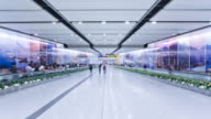 Commuters on a moving walking transiting Hong Kong Central MTR Station, Hong Kong, China, Time-lapse