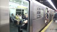 Commuters on subway station platform waiting for local C train / Midtown Manhattan New York City USA