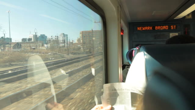 Commuters on train to Newark NJ