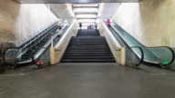 Commuters passing through escalators timelapse