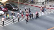 Commuters use a crosswalk in the Makati district of Manila the Philippines on Tuesday May 3 2016