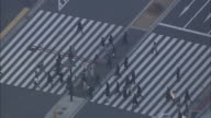 Commuters use the crosswalk on the Marunouchi side of Tokyo Station.