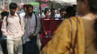 Commuters waiting at bus stop near Connaught Place Auto Rickshaw traffic near New Delhi Station Commuters and auto rickshaws near Red Fort in Old...