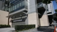 Commuters walk past the entrance of the EVO condominium building in downtown Los Angeles California US Shots of the parking garage entrance to an EVO...