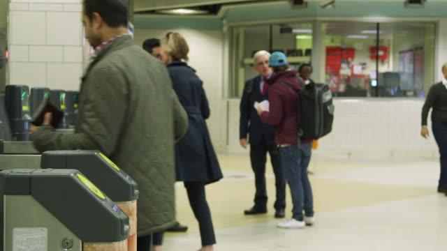 MS Commuters walking past turnstile / Liverpool Street Underground Station, London, England, United Kingdom