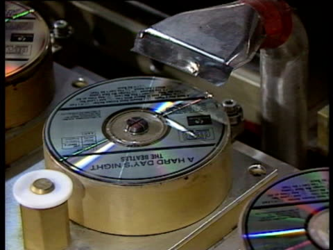 Compact disc production CD of 'A Hard Day's Night' being pressed and brief shot of hands holding Walkman video CD CD production on September 03 1987...