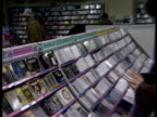 Compact discs on display in music store as people shop INT Music Store people shopping for CDs on September 03 1987 in London