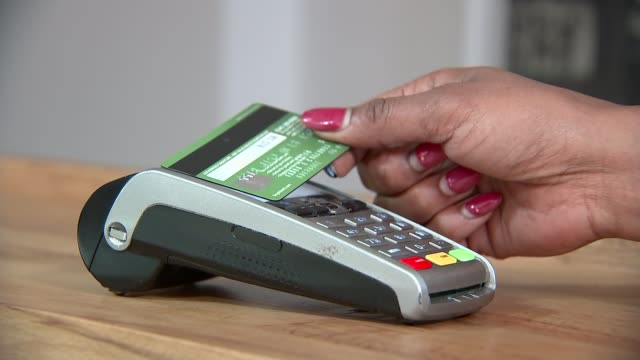 US company to microchip employees London Credit card being scanned by chip and PIN card reader iPhone being scanned by card reader