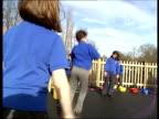 Cambridgeshire Schoolchildren skipping in playground INT Teacher Sandra Adderley talking to child in sick room SOT do you feel hot Sandra Adderley...