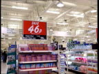 Competition concern over prices ITN London Special price sign GV 'Save' sign above shelves CS Price saving sign LA MS ASDA Roll Back promotional sign...