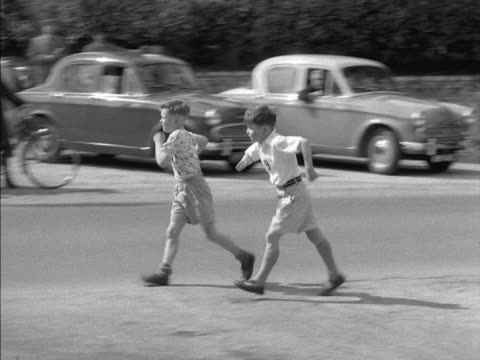 A competitor takes a wrong turn during a walking race at Steyning in Sussex